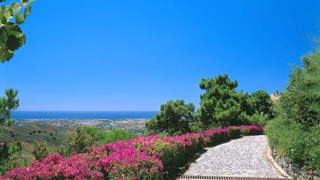 El Madronal hilltop estate with tennis court 33000m2 plot & sea views