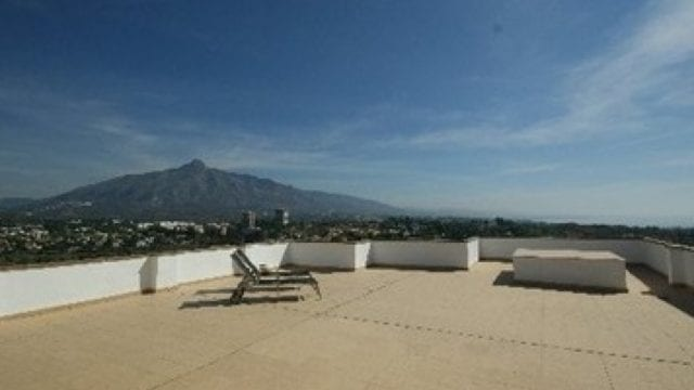 Bargain Nueva Andalucia penthouse with huge terrace and sea views